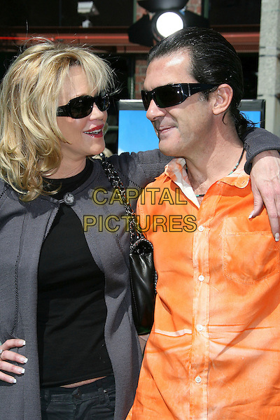 "MELANIE GRIFFITH & ANTONIO BANDERAS.Dreamworks ""Shrek The Third"" Los Angeles Premiere held at the Mann Village Theater, Westwood, California , USA, 06 May 2007..half length orange shirt suglasses husband wife.CAP/ADM/RE.©Russ Elliot/AdMedia/Capital Pictures."