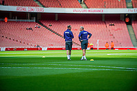 ( L-R )  Head of Sports Science, Jonny Northeast and Alan Curtis, First-team coach of Swansea City set up prior to the Premier League match between Arsenal and Swansea City at Emirates Stadium on October 15, 2016 in London, England.