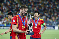 Spain's Fabian Ruiz bites the trophy at the end of the Uefa Under 21 Championship 2019 football final match between Spain and Germany at Udine's Friuli stadium, Italy, June 30, 2019. Spain won 2-1.<br /> UPDATE IMAGES PRESS/Isabella Bonotto