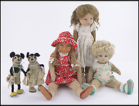 BNPS.co.uk (01202 558833)Pic: Burstow&amp;Hewett/BNPS<br /> <br /> The Queen's five dolls<br /> <br /> Five of the Queen's dolls and a selection of her childhood clothes have emerged for sale.<br /> <br /> The garments and toys were given to the former royal nurse Clara Knight who looked after Queen Elizabeth in her early years while the Queen Mother was undertaking ceremonial duties.<br /> <br /> There are approximately 20 garments in the collection including infants dresses and matching undergarments, many in silks and linen and some in early man made fabrics.