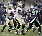 New Orleans Saints  quarterback Drew Brees drops back to pass against the Seattle Seahawks during the 2nd round in a NFL Western Division playoff game at CenturyLink Field in Seattle, Washington on January 11, 2014.  Seahawks beat the Saints 22-15 to take home-field advantage in the NFL Championship Game. ©2014. Jim Bryant Photo. ALL RIGHTS RESERVED.