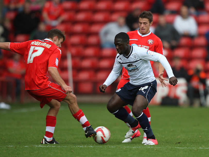 Preston North End's Jeffrey Monakana battles with Walsall's George Bowerman ..Football - npower Football League Division One - Walsall v Preston North End - Saturday 22nd September 2012 - Banks's Stadium - Walsall..