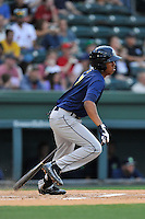 Shortstop Milton Ramos (7) of the Columbia Fireflies bats in a game against the Greenville Drive on Thursday, April 21, 2016, at Fluor Field at the West End in Greenville, South Carolina. Columbia won, 13-9. (Tom Priddy/Four Seam Images)