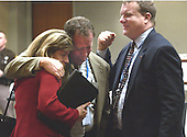 Fairfax County (Virginia) Sniper Task Force supervisor, Lieutenant Bruce Guth, center is comforted by United States Federal Bureau of Investigation (FBI) employee Melissa Thomas, left, and FBI special agent Mike McCoy, right, after the sentence of death was recommended by a jury in the case of convicted sniper John Allen Muhammad at the Virginia Beach Circuit Court in Virginia Beach, Virginia on Monday November 24, 2003. <br /> Credit: Davis Turner - Pool via CNP