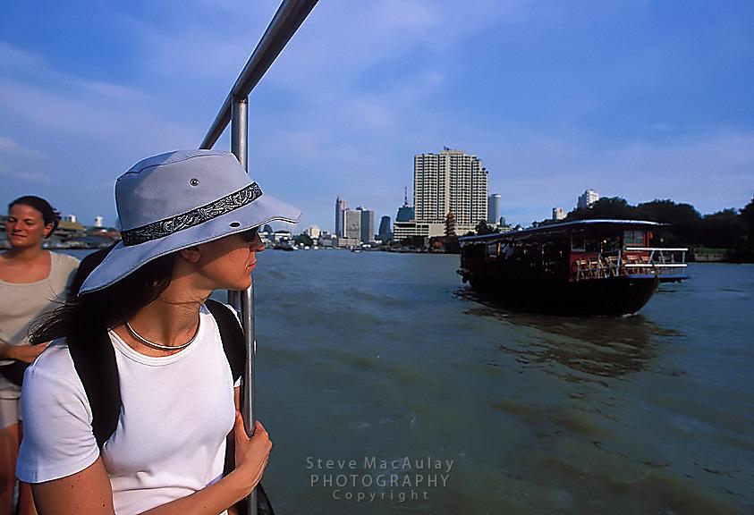 Female traveler on river boat, Chao Praya River, Bangkok, Thailand