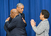 United States President Barack Obama , center, hugs US Representative John Lewis (Democrat of Georgia), left, after making remarks at a session hosted by the White House Office of Public Engagement on strengthening and protecting the right to vote at the White House in Washington, DC on Thursday, August 6, 2015. The event was attended by civil rights leaders, faith leaders, voting rights activists and state and local officials.  US Attorney General Loretta Lynch is at right.<br /> Credit: Ron Sachs / Pool via CNP