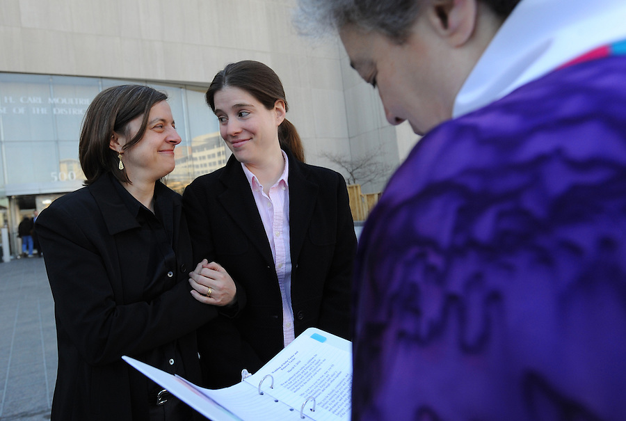 Delia and Rebecca Taylor, of Washington, DC, are married by Rev. Bonnie Berger outside of the Superior Court of D.C. on Tuesday, March 9, 2009. The Taylor's were among the first same-sex couples to wed in the District of Columbia.