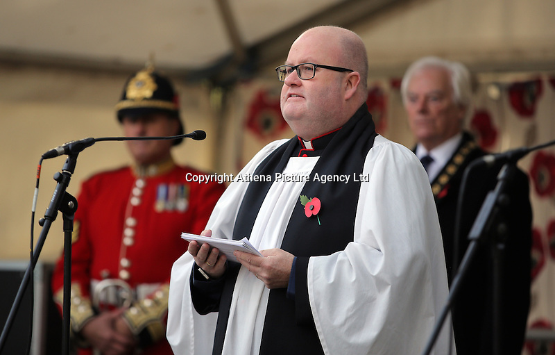Pictured: A priest leads prayers during the service Friday 11 November 2016<br /> Re: Remembrance Day service at Castle Square Gardens in Swansea, south Wales, UK.