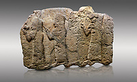 Picture &amp; image of Hittite monumental relief sculpted orthostat stone panel of a Procession. Limestone, Karkamıs, (Kargamıs), Carchemish (Karkemish), 900 - 700 B.C. Anatolian Civilisations Museum, Ankara, Turkey.<br /> <br /> It is a depiction of three marching female figures in long dress with a high headdress (photos) at their head. These women are considered to be the nuns of the Goddess Kubaba. The figure in the front has a small animal in her right hand while the figure in the middle has a glass in his right hand. The object which the figures carry in their left is not understood.  <br /> <br /> Against a gray background.