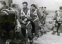 BNPS.co.uk (01202 558833)<br /> Pic: HannBooks/BNPS<br /> <br /> PICTURED: Fixing the 'parachutes' 5 minutes before take off.<br /> <br /> Remarkable photos taken deep behind enemy lines by an SAS unit during a daring wartime operation have come to light on the 75th anniversary of the mission. <br />  <br /> The little-known Operation Galia on the 27th December 1944 involved just 33 SAS men hoodwinking the Nazis and their fascist allies into thinking a much greater force had landed behind them in Italy in December 1944.<br />  <br /> Adolf Hitler's forces had just launched a major surprise offensive in the Ardennes Forest in Belgium that became known as the Battle of the Bulge.<br /> <br /> Robert Hann, whose late father was SAS Paratrooper Stanley Hann, retraced his father's wartime experiences and part of his [father's] epic 80 mile long escape route through the Apennine mountains which the men took, to help him write the book 'SAS Operation Galia.'