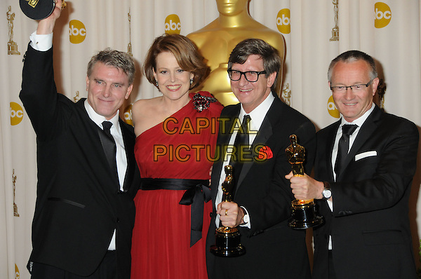 GUESTS - Sigourney Weaver, Robert Stromberg, Rick Carter and Kim Sinclair..82nd Annual Academy Awards held at the Kodak Theatre, Hollywood, California, USA..March 7th, 2010.oscars  award trophy winner half length suit red one shoulder dress black white.CAP/ADM/BP.©Byron Purvis/AdMedia/Capital Pictures.