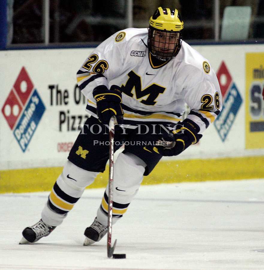 19 October 2006: Michigan forward Danny Fardig (26) dribbles the puck up the rink during Michigan's 6-3 win in their CCHA season opener against Miami (OH) at Yost Ice Arena in Ann Arbor, MI.