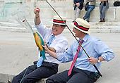 """Stephen Colbert, host of the Comedy Central show """"The Colbert Report"""" works on a bit with United States Representative Jack Kingston (Democrat of Georgia) where they appear to be fishing in U.S. Capitol Reflecting Pool in Washington, D.C. on Friday, October 3, 2014.<br /> Credit: Ron Sachs / CNP<br /> (RESTRICTION: NO New York or New Jersey Newspapers or newspapers within a 75 mile radius of New York City)"""