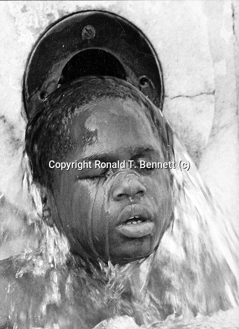 Little boy cools off on a hot Washington DC day in August.  Black and White photography, Black & White, Fine art photography in black and white, Ron Bennett Photographer,
