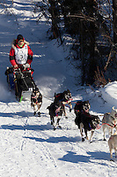 Musher Ray Redington Jr. on Long Lake at the Re-Start of the 2011 Iditarod Sled Dog Race in Willow, Alaska.