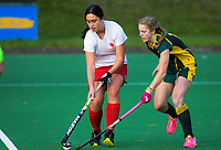 Action from the Wellington Hockey women's open grade premier one match between Victoria University of Wellington (green and gold) and Toa at National Hockey Stadium in Wellington, New Zealand on Saturday, 26 May 2018. Photo: Dave Lintott / lintottphoto.co.nz