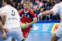 08 JAN 2012 - LONDON, GBR - Great Britain playmaker Ciaran Williams (#3, in red) looks for a way through the Austrian defence during the men's 2013 World Handball Championships qualification match at the National Sports Centre in Crystal Palace, Great Britain (PHOTO (C) 2012 NIGEL FARROW)