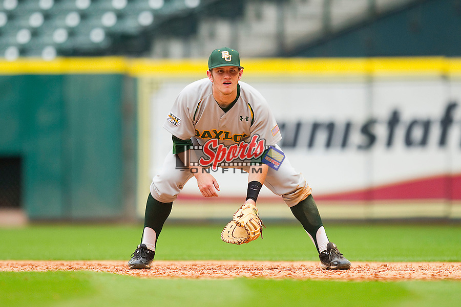 First baseman Max Muncy #9 of the Baylor Bears on defense against the Houston Cougars at Minute Maid Park on March 4, 2011 in Houston, Texas.  Photo by Brian Westerholt / Four Seam Images