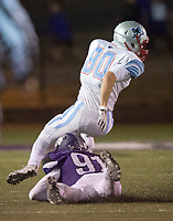 NWA Democrat-Gazette/CHARLIE KAIJO Southside High School wide receiver Mason Love (80) escapes Fayetteville High School kicker Porter Smith (91) during a playoff football game on Friday, November 10, 2017 at Fayetteville High School in Fayetteville.