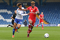 Milton Keynes Dons' Aaron Tshibola vies for possession with Bury's Josh Laurent<br /> <br /> Photographer Juel Miah/CameraSport<br /> <br /> The EFL Sky Bet League One - Bury v Milton Keynes Dons - Saturday 30th September 2017 - Gigg Lane - Bury<br /> <br /> World Copyright &copy; 2017 CameraSport. All rights reserved. 43 Linden Ave. Countesthorpe. Leicester. England. LE8 5PG - Tel: +44 (0) 116 277 4147 - admin@camerasport.com - www.camerasport.com