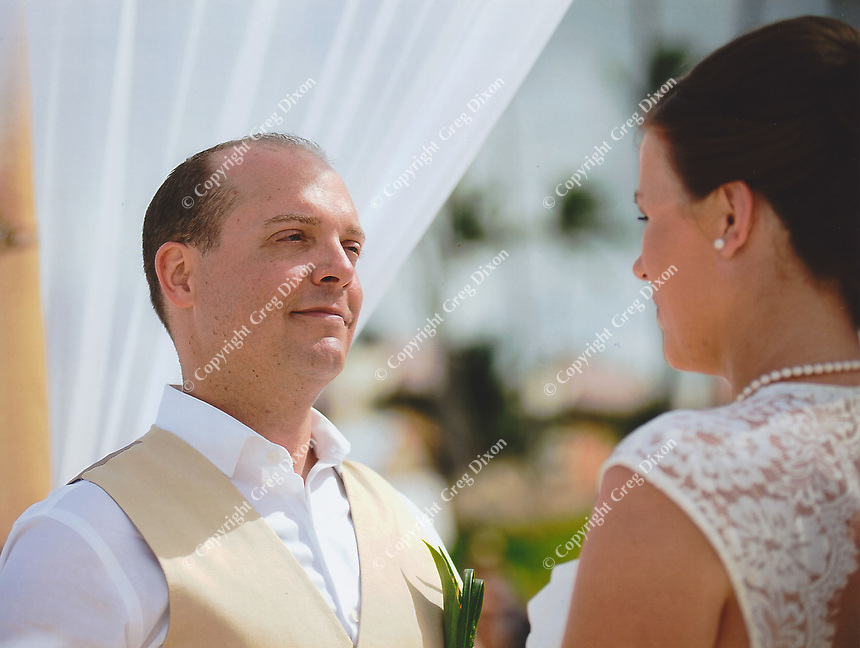 Jared looks into Allison's eyes during the exchange of vows