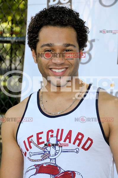 "Actor Corbin Bleu attends the ""Bing Summer Of Doing"" with Dosomething.org by restoring CITYarts Mosaic Peace Wall at the Jacob H. Schiff Playground on July 10, 2012 in New York City. © mpi81 / MediaPunch Inc."