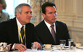 Governor Bill Ritter (Democrat of Colorado), left, and Governor Arnold Schwarzenegger (Republican of California), right, listen to United States President George W. Bush address the National Governors Association in the State Dining Room of the White House in Washington, DC on February 25, 2008, <br /> Credit: Dennis Brack - Pool via CNP