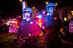 SACRAMENTO, CALIFORNIA - MARCH 30, 2018: California Highway Patrol Officers block Black Lives Matter protestors from marching onto Interstate 5. In the days since Stephon Clark, 22, was fatally shot by officers investigating a vandalism complaint in his south Sacramento neighborhood, protesters have stormed City Hall and taken to the streets in anger. CREDIT: Max Whittaker for The New York Times