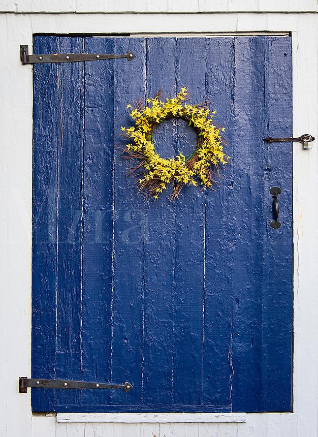 Simple flower wreath on rustic blue door.