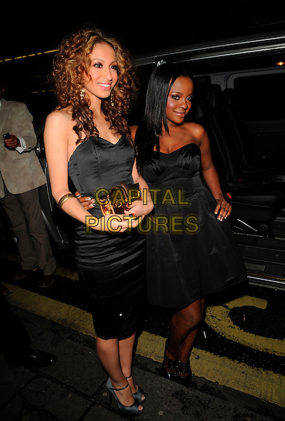 "AMELLE BERRABAH & KEISHA BUCHANAN.The ""27 Dresses"" VIP screening, Apollo West End cinema, London, England..March 4th, 2008.full length strapless dress black  sugababes gold clutch bag purse cigarette manicure nails .CAP/CAN.©Can Nguyen/Capital Pictures."