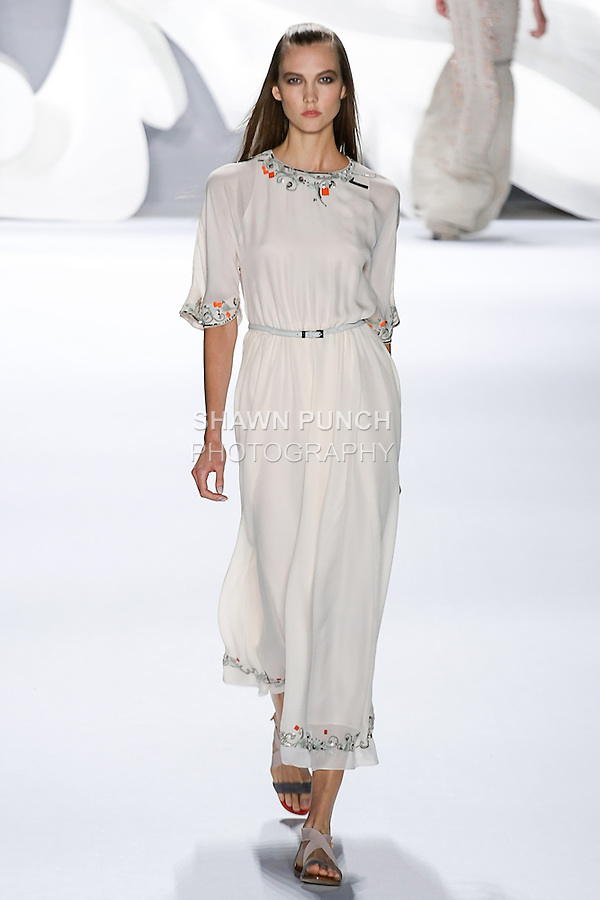 Karlie Kloss walks runway in an outfit from the Carolina Herrera Spring 2013 Timeless Influence collection, during Mercedes-Benz Fashion Week Spring 2013 in New York City.