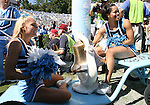 02 September 2006: Two UNC cheerleaders with the bell. The University of North Carolina Tarheels lost 21-16 to the Rutgers Scarlett Knights at Kenan Stadium in Chapel Hill, North Carolina in an NCAA Division I College Football game.