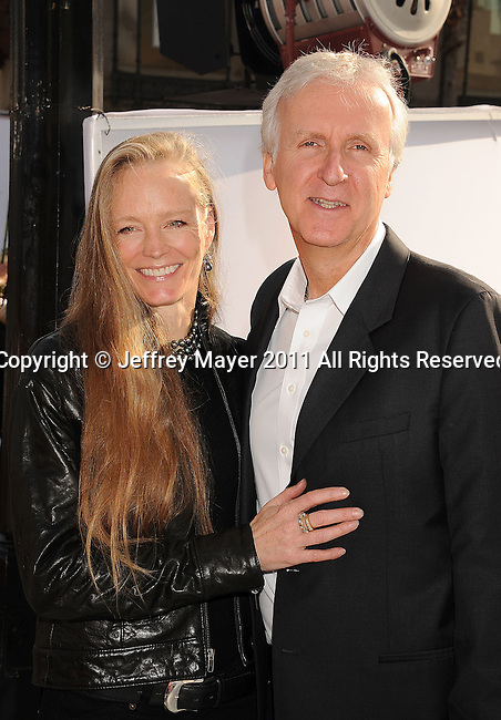 "HOLLYWOOD, CA - SEPTEMBER 25: Suzy Amis and James Cameron attend Premiere Of ""Iris"" - A Journey Into The World Of Cinema By Cirque du Soleil at the Kodak Theatre on September 25, 2011 in Hollywood, California."