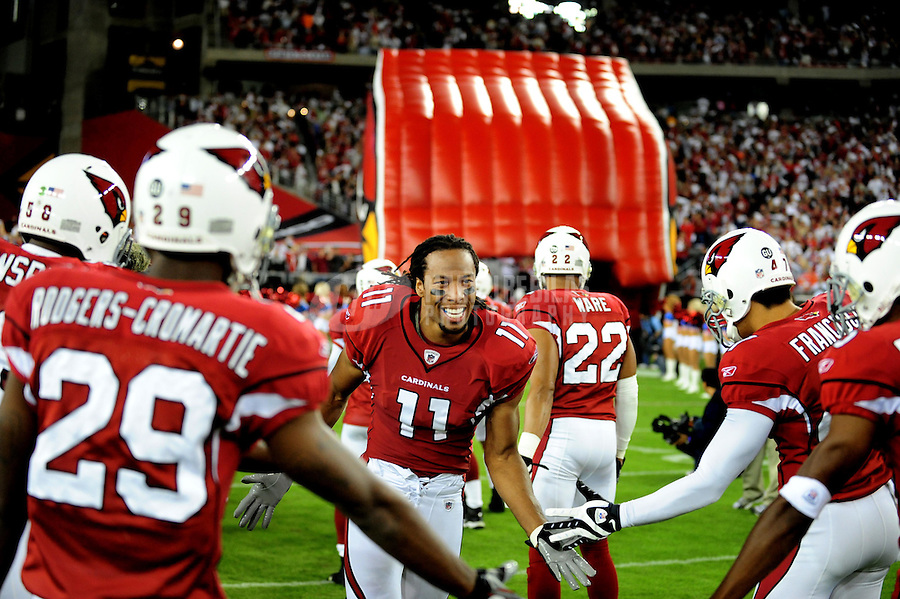 Nov. 10, 2008; Glendale, AZ, USA; Arizona Cardinals wide receiver (11) Larry Fitzgerald runs onto the field prior to the game against the San Francisco 49ers at University of Phoenix Stadium. The Cardinals defeated the 49ers 29-24. Mandatory Credit: Mark J. Rebilas-