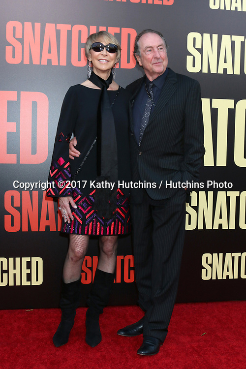"LOS ANGELES - MAY 10:  Tania Kosevich, Eric Idle at the ""Snatched"" World Premiere at the Village Theater on May 10, 2017 in Westwood, CA"