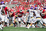 Wisconsin Badgers running back James White (20) carries the ball during an NCAA football game against the Tennessee Tech Golden Eagles  Saturday, September 7, 2013, in Madison, Wis. (Photo by David Stluka)