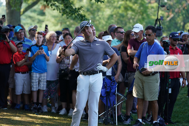 Rory McIlroy (NIR) asks the spectators to move so he can hit his second shot out of the rough on the 18th hole during the second round of the 100th PGA Championship at Bellerive Country Club, St. Louis, Missouri, USA. 8/11/2018.<br /> Picture: Golffile.ie | Brian Spurlock<br /> <br /> All photo usage must carry mandatory copyright credit (© Golffile | Brian Spurlock)