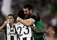 Calcio, Tim Cup: finale Juventus vs Lazio. Roma, stadio Olimpico, 17 maggio 2017.<br /> Juventus&rsquo; Dani Alves, left, celebrates with his teammate Gianluigi Buffon after scoring during the Italian Cup football final match between Juventus and Lazio at Rome's Olympic stadium, 17 May 2017.<br /> UPDATE IMAGES PRESS/Isabella Bonotto