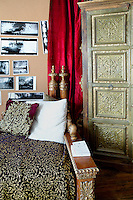 Carved wooden couch and brass wardrobe
