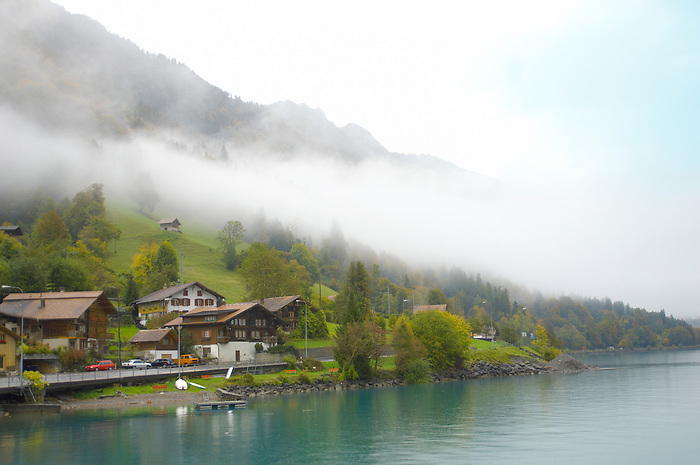 Interlaken Bernese Alps Switzerland - Lake & houses with low clouds