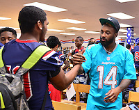 MIAMI, FL - SEPTEMBER 20: Miami Dolphins Wide Receiver (#14) Jarvis Landry surprise the Miramar Patriots varsity football team prior to the teamís practice as part of the 4 Downs for Finance financial literacy program sponsored by BankUnited. Landry share his thoughts on the importance of financial literacy at Miramar High School Media Center on September 20, 2016 in Miramar, Florida. Credit: MPI10 / MediaPunch