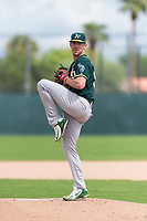 Oakland Athletics starting pitcher Chris Bassitt (58) delivers a pitch during an exhibition game against Team Italy at Lew Wolff Training Complex on October 3, 2018 in Mesa, Arizona. (Zachary Lucy/Four Seam Images)