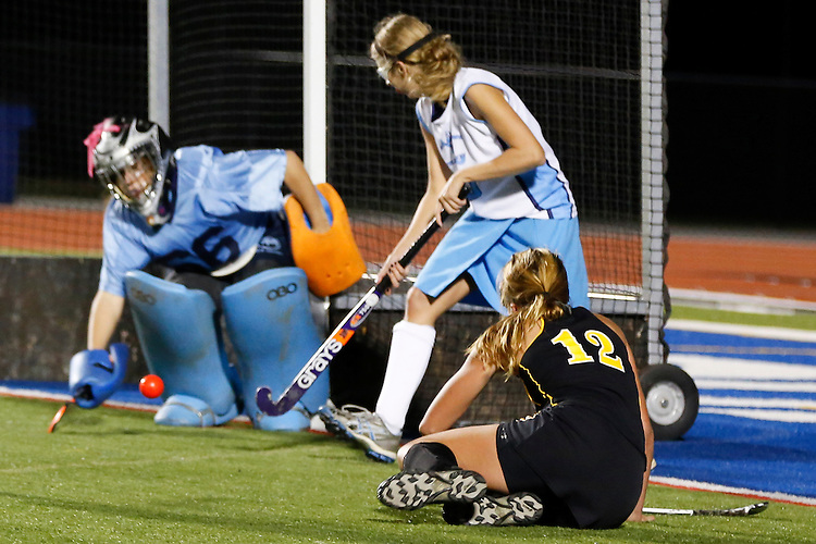 Red Lion's Morgan Kuehne, right, attempts a goal against Dallastown's goalkeeper Niki Bream, left, during overtime in Thursday's YAIAA field hockey championship title game. The teams battled through two scoreless overtimes before Dallastown won in a shootout. (For the Daily Record/Sunday News -- Shane Keller)