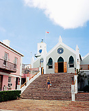 BERMUDA, St. George, woman walking on steps of St. Peter's Church