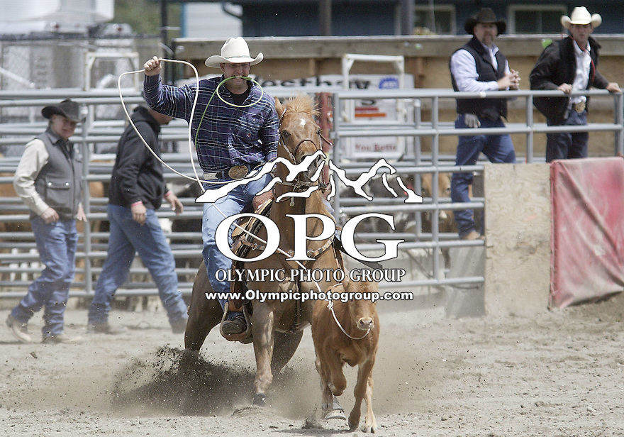 24 June 2007:   Tim Yore from Winlock, WA scored a 23.3 in the Tie Down Roping competition at the Kitsap County Thunderbird Benefit Pro Rodeo in Bremerton, Washington.