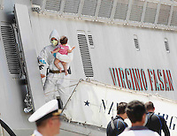 Operazione Mare Nostrum , immigrati in scendono al porto di Napoli dalla nave Virginio Fasan, impiegata nell operazione Mare Nostrum <br /> un bambino tra le braccia dei siccoritoriMigrants  disembark in Naples Harbour <br />  from the ship &quot;Virginio Fasan&quot; of the Italian navy,  the  vessel involved in search-and-rescue operations the ship is engaged in the rescue operation &quot;Mare Nostrum&quot; in the Mediterranean Sea
