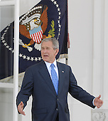 Washington, DC - March 5, 2008 -- United States President George W. Bush clowns for the cameras as he awaits the arrival of United States Senator John McCain (Republican of Arizona) the presumptive 2008 Republican nominee fore President of the United States on the North Portico of the White House on Wednesday, March 5, 2008..Credit: Ron Sachs / CNP