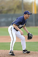 Takashi Sasito #40 of the Milwaukee Brewers participates in pitchers fielding practice during spring training workouts at the Brewers complex on February 18, 2011  in Phoenix, Arizona. .Photo by Bill Mitchell / Four Seam Images.