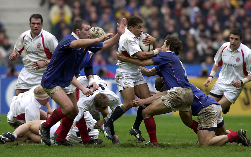 Photo.Richard Lane.France v England at Stade de France. 2-3-2002. Lloyds TSB Six Nations Championship..Jason Robinson is surrounded by French tacklers.