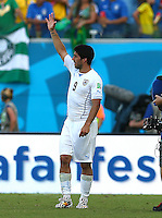 Luis Suarez of Uruguay waves to the fans at full time
